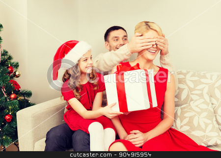 father and daughter surprise mother with gift box stock photo, family, christmas, x-mas, happiness and people concept - smiling father and daughter surprise mother with big gift box by Syda Productions