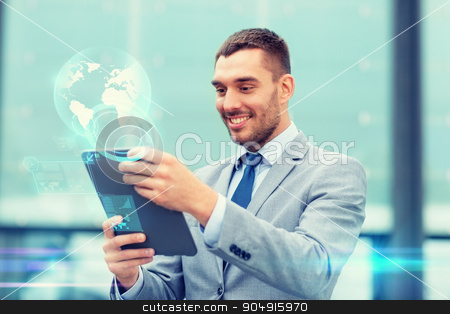 smiling businessman with tablet pc outdoors stock photo, business, education, technology and people concept - smiling businessman working tablet pc computer, virtual screens and globe hologram on city street by Syda Productions