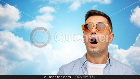 face of scared man in shirt and sunglasses stock photo, summer, emotions, style and people concept - face of scared or surprised middle aged latin man in shirt and sunglasses over blue sky and clouds background by Syda Productions