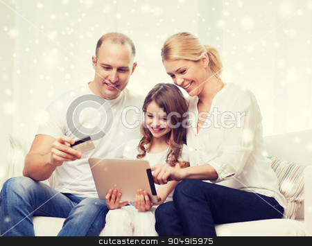 happy family with tablet pc and credit card stock photo, family, holidays, shopping, technology and people concept - happy family with tablet pc computer and credit card over snowflakes background by Syda Productions