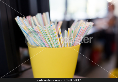 close up of cocktail straws in glass at restaurant stock photo, object and device concept - close up of cocktail straws in glass at restaurant by Syda Productions
