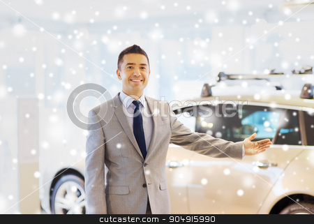 happy man at auto show or car salon stock photo, auto business, car sale, consumerism and people concept - happy man at auto show or salon over snow effect by Syda Productions