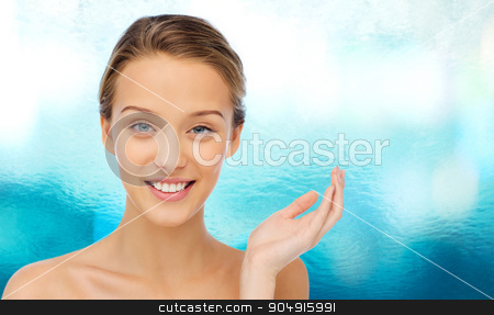 smiling young woman face and shoulders stock photo, beauty, people and health concept - smiling young woman face and shoulders by Syda Productions