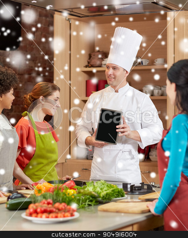 happy women with chef and tablet pc in kitchen stock photo, cooking class, culinary, food, technology and people concept - happy women with chef cook showing blank tablet pc screen in kitchen over snow effect by Syda Productions