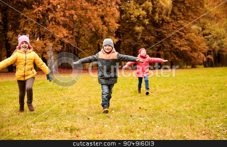 happy little children running and playing outdoors stock photo, autumn, childhood, leisure and people concept - group of happy little children running and playing planes outdoors by Syda Productions