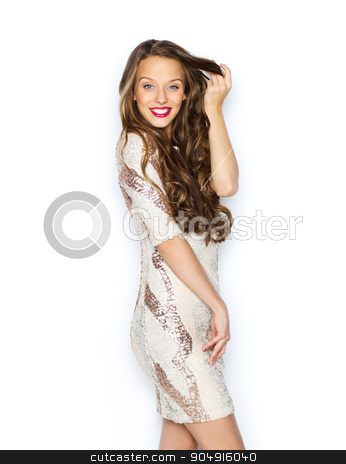 happy young woman or teen girl in fancy dress stock photo, people, style, holidays, hairstyle and fashion concept - happy young woman or teen girl in fancy dress with sequins touching long wavy hair by Syda Productions