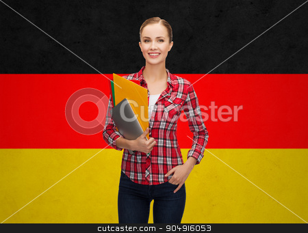 happy student girl with tablet pc and folders stock photo, people, education, learning and school concept - happy and smiling teenage student girl with tablet pc and folders over german flag background by Syda Productions