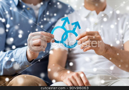 close up of happy male gay couple with love symbol stock photo, people, homosexuality, same-sex marriage and love concept - close up of happy male gay couple holding paper cutout love symbol over snow effect by Syda Productions