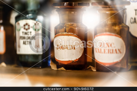 vintage medications in small bottles  stock photo, vintage medications in small bottles on a shelf by MegaArt