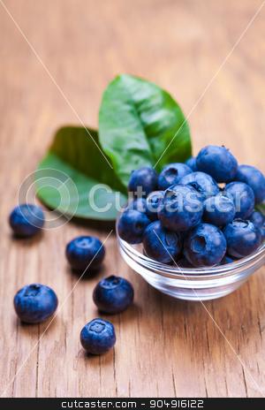 Fresh blueberries in a bowl  stock photo, Fresh blueberries in a bowl on wooden background by MegaArt