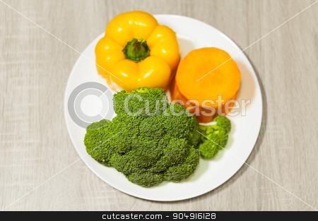 organic broccoli, pepper and pumpkin  stock photo, organic broccoli, pepper and pumpkin on a plate by MegaArt