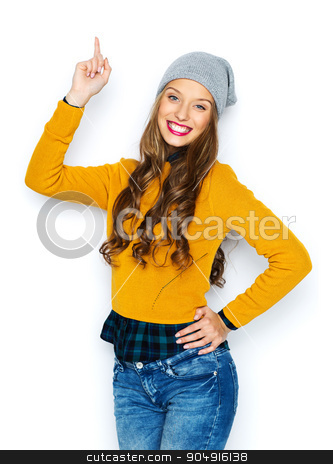 happy young woman or teen girl pointing finger up stock photo, people, style and fashion concept - happy young woman or teen girl in casual clothes and hipster hat pointing finger up by Syda Productions