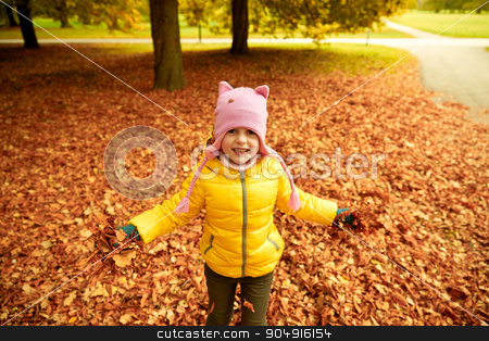 happy girl playing with autumn leaves in park stock photo, autumn, childhood, nature and people concept - happy little girl playing with fallen leaves in park by Syda Productions
