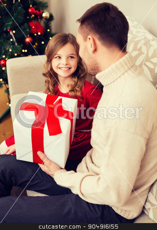 smiling father and daughter looking at each other stock photo, family, christmas, x-mas, happiness and people concept - smiling father and daughter holding gift box and looking at each other by Syda Productions