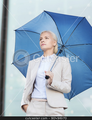 young serious businesswoman with umbrella outdoors stock photo, business, bad weather and people and concept - young serious businesswoman with umbrella outdoors by Syda Productions