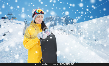 happy young woman with snowboard over mountains stock photo, winter, leisure, sport and people concept - happy young woman in ski goggles with snowboard over snow and mountain background by Syda Productions