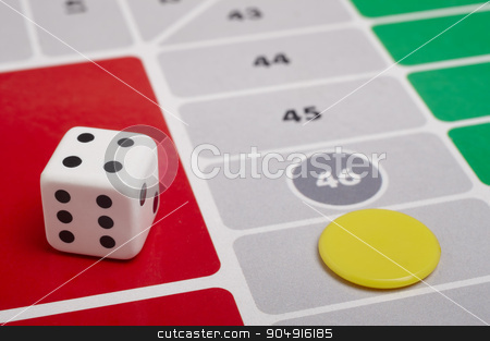 Parcheesi board game detail with dice and game piece stock photo, Parcheesi board game detail with dice and game piece. Horizontal by ABBPhoto