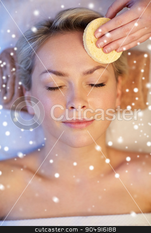 close up of woman having face massage in spa salon stock photo, people, beauty, spa, healthy lifestyle and relaxation concept - close up of beautiful young woman lying with closed eyes and having face massage with sponge in spa with snow effect by Syda Productions