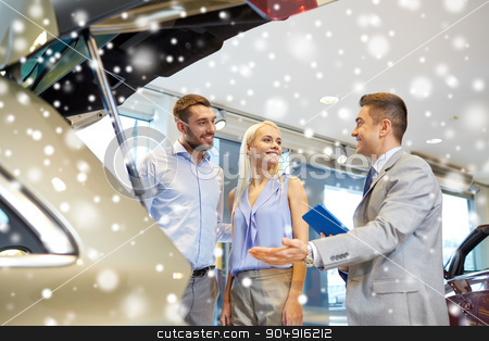 happy couple with car dealer in auto show or salon stock photo, auto business, car sale and people concept - happy couple with car dealer in auto show or salon over snow effect by Syda Productions
