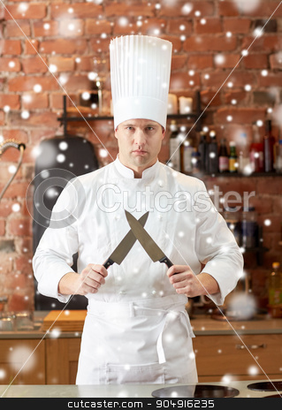 happy male chef cook in kitchen with knife stock photo, cooking, kitchenware and people concept - happy male chef cook with knife in restaurant kitchen over snow effect by Syda Productions