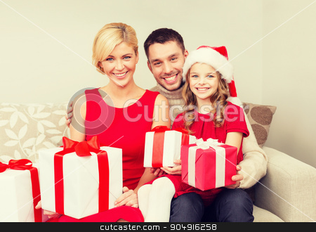 smiling family holding many gift boxes stock photo, family, christmas, x-mas, winter, happiness and people concept - smiling family in santa helper hats with many gift boxes by Syda Productions