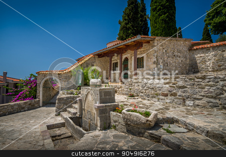 Historical buildings in Old Town of Bar stock photo, Historical buildings in Old Town of Bar, stone house and drinkable water tap. Bar, Montenegro by Alexander Nikiforov