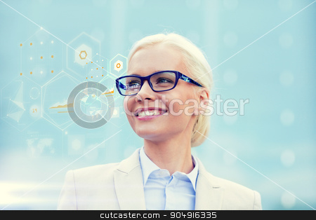 young smiling businesswoman in eyeglasses outdoors stock photo, business, people, development and future technology concept - young smiling businesswoman in eyeglasses with virtual screen and charts projection outdoors by Syda Productions