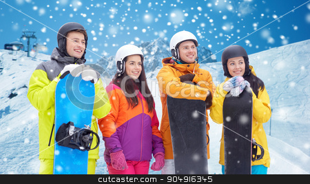 happy friends with snowboards over mountains stock photo, winter, leisure, extreme sport, friendship and people concept - happy friends in helmets with snowboards over snow and mountain background by Syda Productions