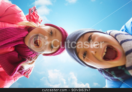happy little boy and girl faces over blue sky stock photo, childhood, leisure, friendship, autumn and people concept - happy boy and girl faces outdoors over blue sky and clouds background by Syda Productions