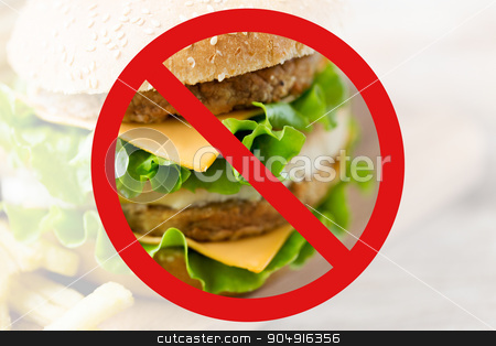 close up of hamburger behind no symbol stock photo, fast food, low carb diet, fattening and unhealthy eating concept - close up of hamburger or cheeseburger behind no symbol or circle-backslash prohibition sign by Syda Productions