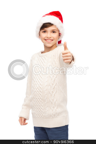 smiling happy boy in santa hat showing thumbs up stock photo, holidays, gesture, christmas, childhood and people concept - smiling happy boy in santa hat showing thumbs up by Syda Productions