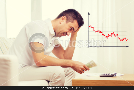 man with money and calculator at home stock photo, business, savings, financial crisis and people concept - upset man with money and calculator at home by Syda Productions
