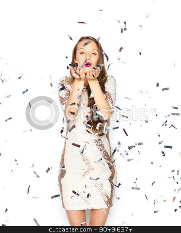 happy young woman or teen girl in fancy dress stock photo, people, holidays, gesture and glamour concept - happy young woman or teen girl in fancy dress with sequins and confetti at party sending blow kiss by Syda Productions