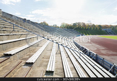 stands with rows of benches on stadium stock photo, sport and architecture concept - stands with rows with benches on stadium by Syda Productions