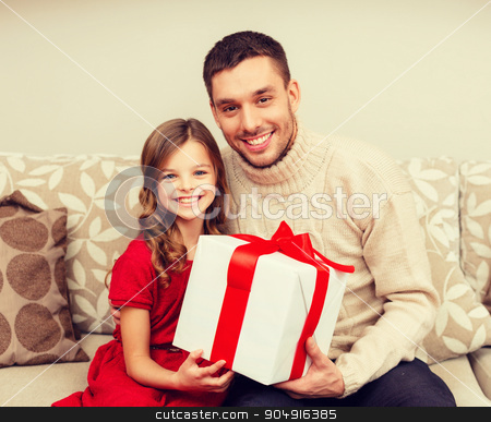 smiling father and daughter holding gift box stock photo, christmas, x-mas, winter, happiness and people concept - smiling father and daughter holding gift box by Syda Productions