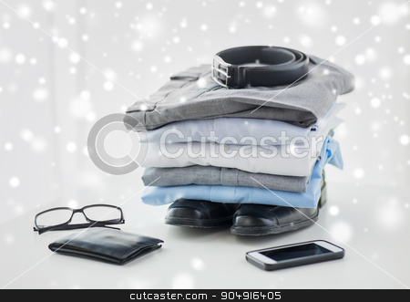 close up of formal clothes and personal stuff stock photo, business, style, clothes and objects concept - close up of formal male clothes and personal stuff on table at home over snow effect by Syda Productions