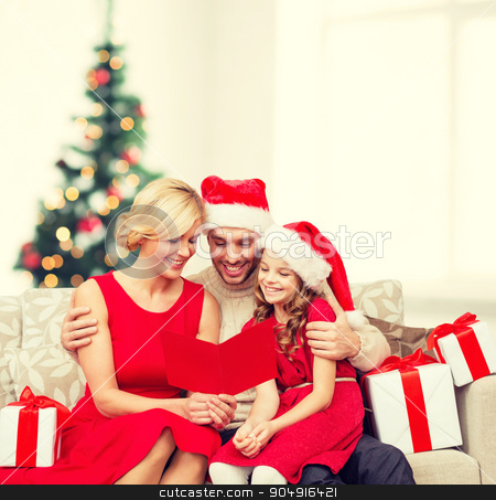 smiling family reading postcard stock photo, family, christmas, x-mas, winter, happiness and people concept - smiling family in santa helper hats with many gift boxes reading postcard by Syda Productions