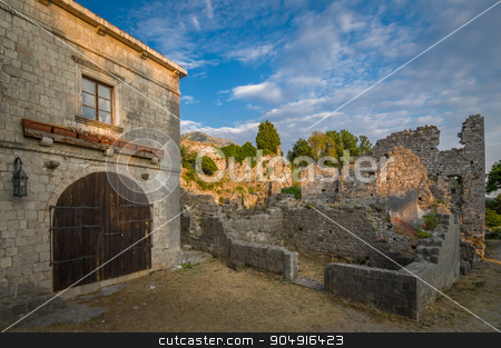 Stari Bar fortress buildings, Montenegro stock photo, Old Town of Bar medieval fortress building with wooden gate and wall ruins, Montenegro by Alexander Nikiforov