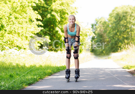 happy young woman in rollerblades riding outdoors stock photo, fitness, sport, summer, rollerblading and healthy lifestyle concept - happy young woman in rollerblades and protective gear riding outdoors by Syda Productions