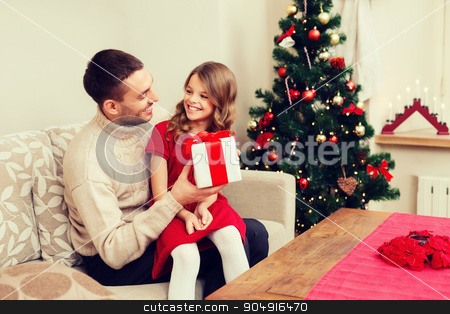 smiling father and daughter looking at each other stock photo, family, christmas, x-mas, winter, happiness and people concept - smiling father and daughter holding gift box and looking at each other by Syda Productions