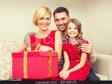 happy family opening gift box stock photo, family, christmas, x-mas, winter, happiness and people concept - happy family opening by Syda Productions