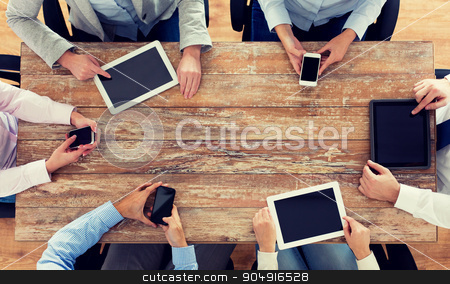 business team with smartphones and tablet pc stock photo, business, people, technology and team work concept - close up of creative team with smartphones and tablet pc computers sitting at table in office by Syda Productions
