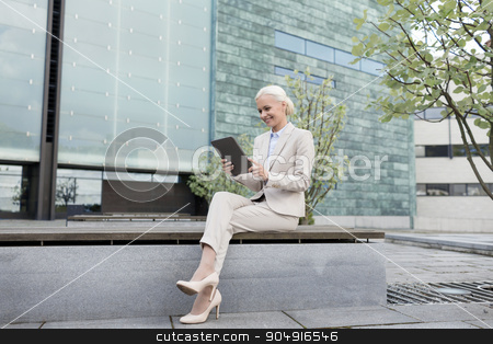smiling businesswoman with tablet pc outdoors stock photo, business, education, technology and people concept - smiling businesswoman working with tablet pc computer on city street by Syda Productions