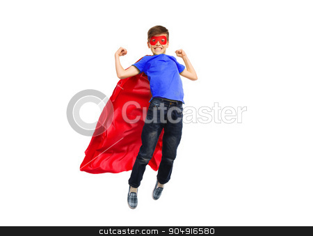 boy in red super hero cape and mask flying on air stock photo, happiness, freedom, childhood, movement and people concept - boy in red super hero cape and mask flying in air by Syda Productions