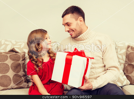 smiling father and daughter looking at each other stock photo, christmas, x-mas, winter, happiness and people concept - smiling father and daughter holding gift box and looking at each other by Syda Productions