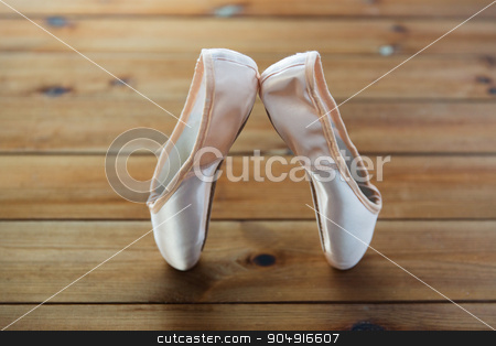 close up of pointe shoes on wooden floor stock photo, ballet, footwear and objects concept - close up of pointe shoes on wooden floor by Syda Productions