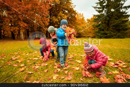 group of children collecting leaves in autumn park stock photo, childhood, leisure, autumn, friendship and people concept - group of children collecting leaves in park by Syda Productions