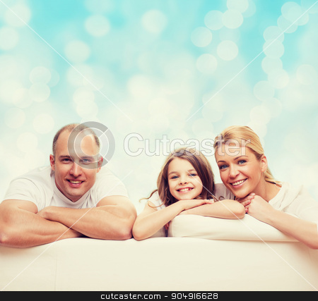 happy family at home stock photo, family, childhood, holidays and people - smiling mother, father and little girl over blue lights background by Syda Productions