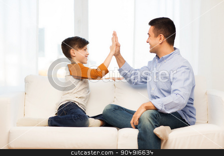 happy father and son doing high five at home stock photo, family, gesture, fatherhood, generation and people concept - happy father and son doing high five at home by Syda Productions