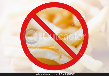 close up of french fries behind no symbol stock photo, fast food, low carb diet, fattening and unhealthy eating concept - close up of french fries behind no symbol or circle-backslash prohibition sign by Syda Productions